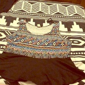 Sleeveless top with tribal design.